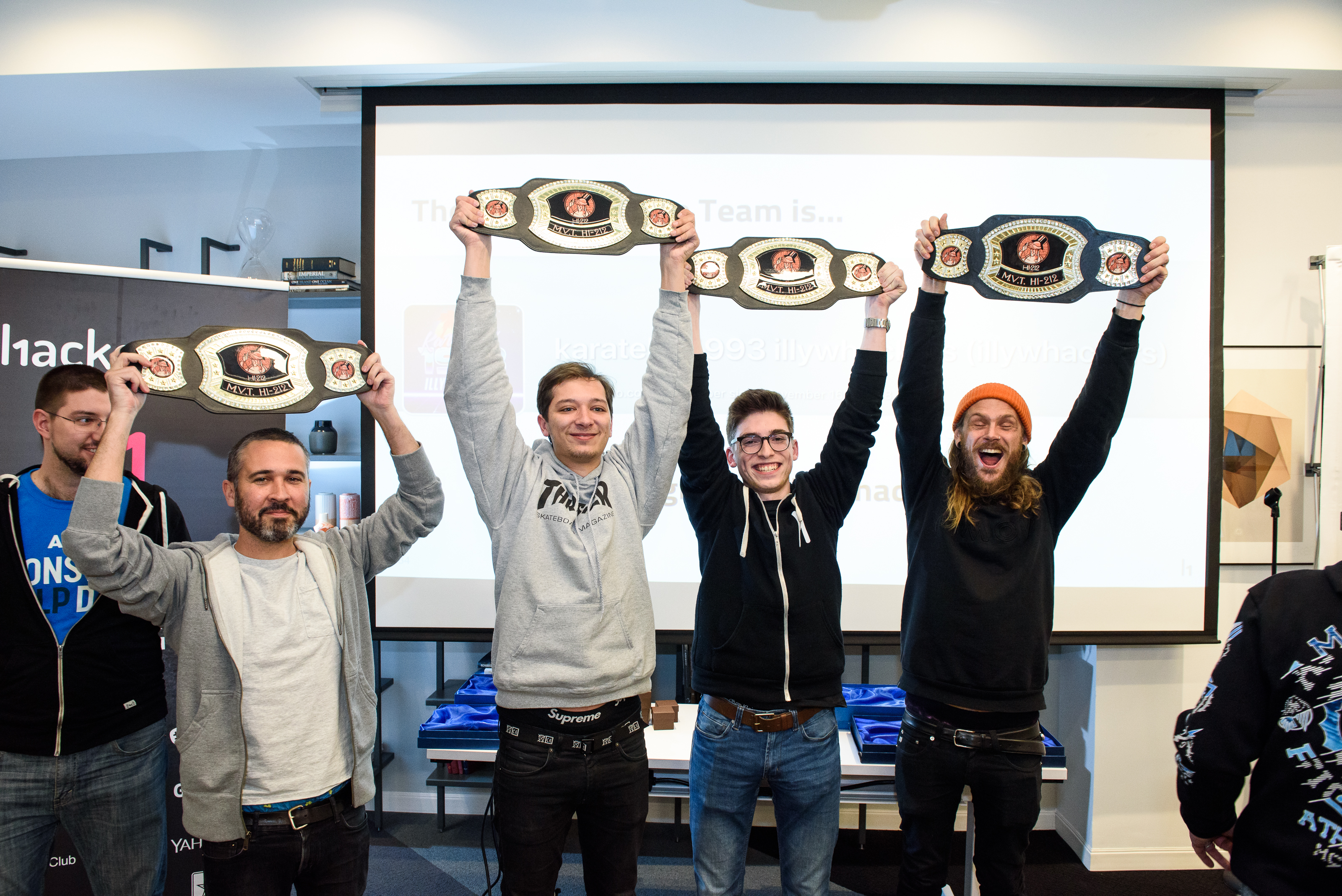 @johnny, @smiegles, @teknogeek and @stok pose with their Most Valuable Team belts at h1-212